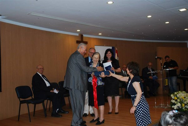DMAH Publishing Manager, Ms. Sawsan Tannoury (back, right), presenting Pastor as-Sharouk's daughter with his Bible