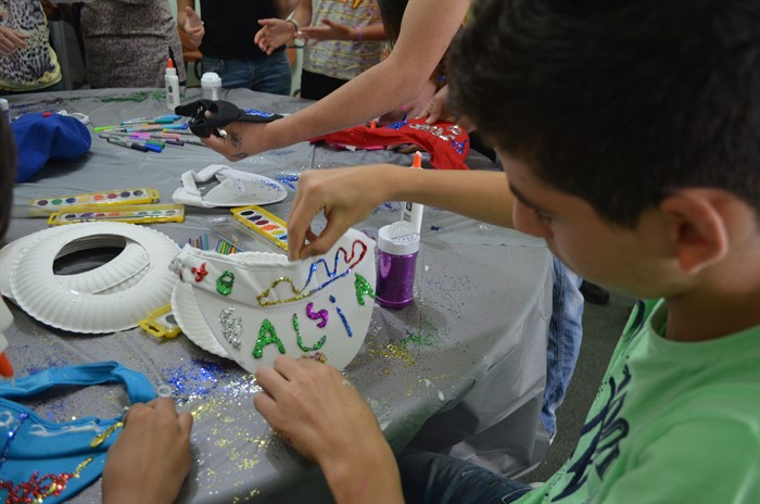 Older children get to express their creativity through an art project during BCYM's weekly programming.