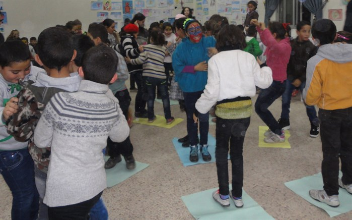 Syrian children engage happily in a silly game at a Child Friendly Space. (Photo: LSESD Staff)