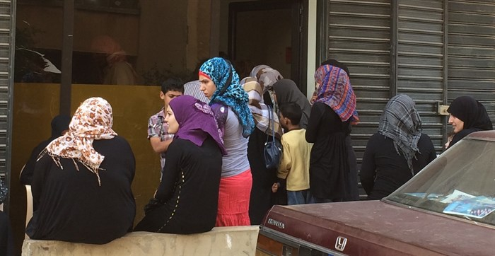 Syrian refugee women waiting to receive free medical services from a church-based ministry in Northern Lebanon (Photo: Ashley al-Saliby)