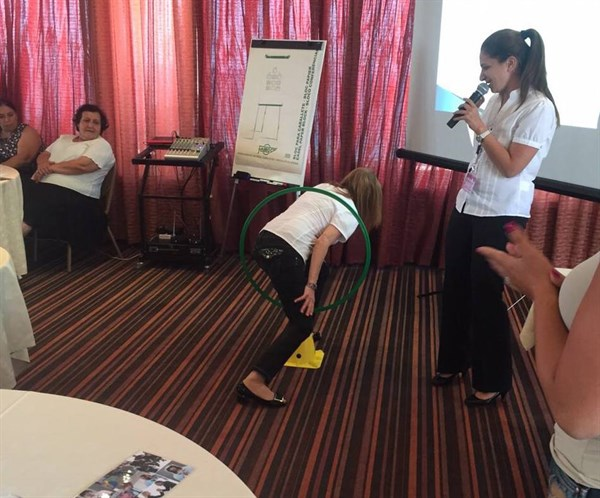 "An occupational therapist demonstrating to teachers how our ability to ""locate our bodies in space"" impacts our ability to read and write."